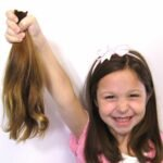 hair-system-hos-wigs-a-fistful-of-ponytails-text-photo-001